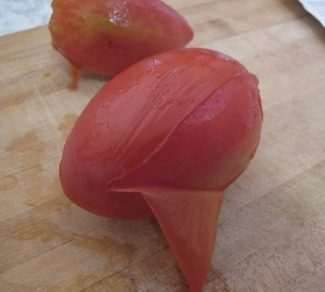 Peeling tomato skins from Roma tomatoes