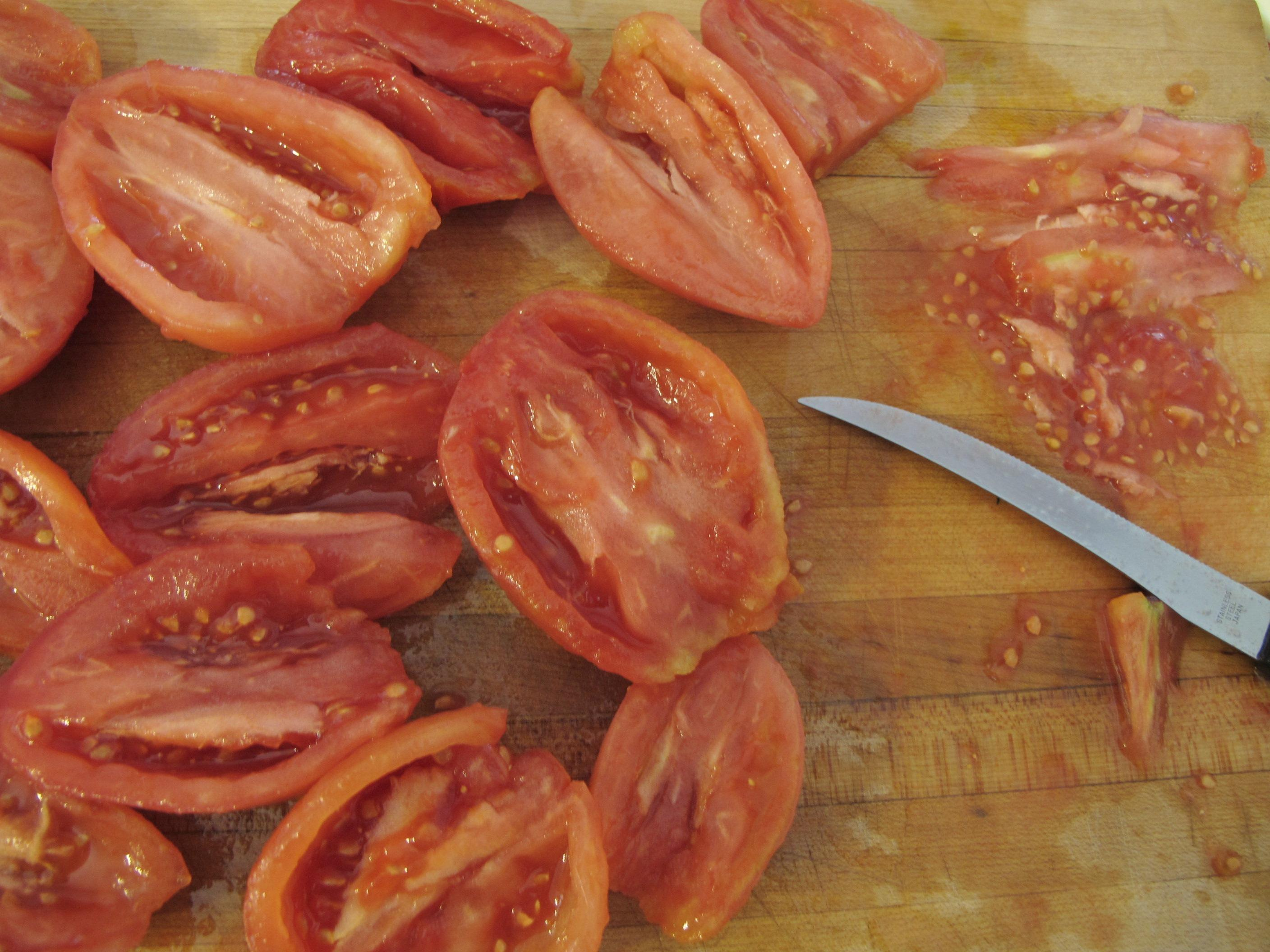 ... tomatoes let in slowly melt in pan while working with tomatoes