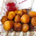 Basket of hush puppies with raspberry hot pepper jelly