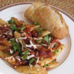 Dinner of Italian Pasta Puttanesca Pugliese with penne