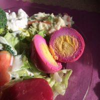 Low carb pickled beet eggs cut in half on a salad
