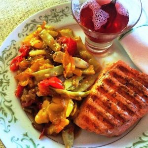 Romano beans with smashed cherry tomatoes and grilled salmon