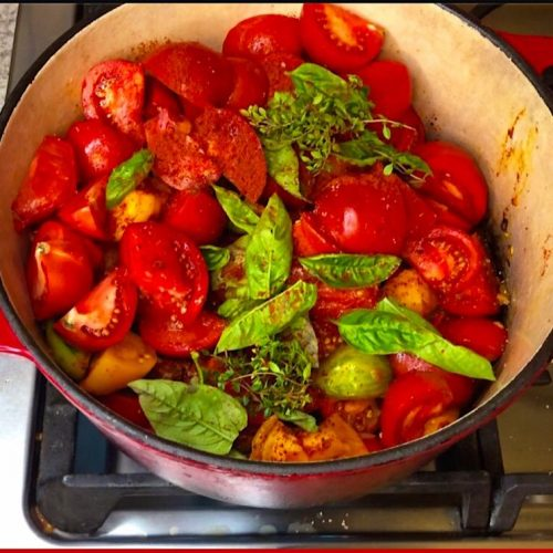 Pot of ingredients for making low carb freezer tomato sauce with fresh tomatoes