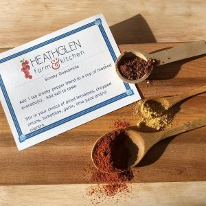 Samples of spice blends displayed on spoons