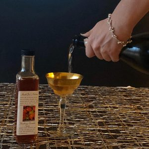 Adding strawberry lavender syrup to champagne for craft cocktail