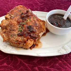 Pork chop drizzled with Cumberland Sauce