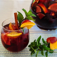 Glass and a pitcher of classic red Sangria